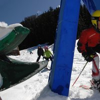 Play time on Cermis  - Child skiing under the obstacle