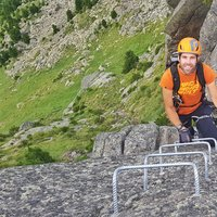 Climber along the lakes ferrata  - A happy climber on Cermiskyline in Val di Fiemme