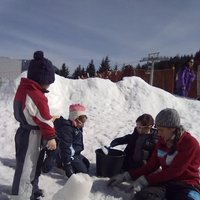 Snow castles on Cermis  - Children have fun building snow castles on Cermis