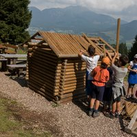 Children play in Val di Fiemme  - Games during the lumberjack day on Cermis