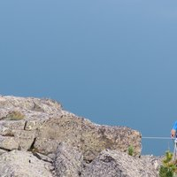 Climber suspended on Cermiskyline  - Picture of a suspended climber on the lakes ferrata in val di Fiemme