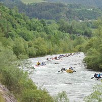 - River crowded by rafts in Val di Fiemme